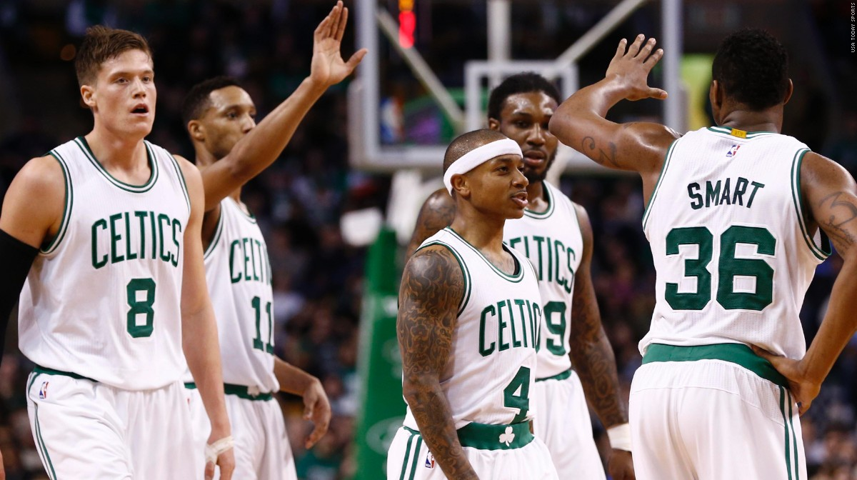 Feb 25, 2015; Boston, MA, USA; Boston Celtics forward Jonas Jerebko (8), guard Evan Turner (11), guard Isaiah Thomas (4), forward Jae Crowder (99) and guard Marcus Smart (36) celebrate against the New York Knicks during the second half at TD Garden. Mandatory Credit: Mark L. Baer-USA TODAY Sports