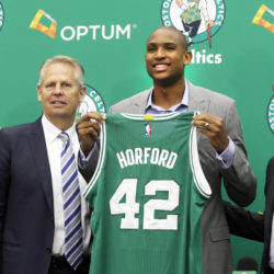070816- Waltham, MA:  : L to R:  Celtics co-owner Wyc Grousbeck, Team president Danny Ainge, newly acquired player Al Horford and Coach Brad Stevens meet the Boston media. Staff photo by John Wilcox.