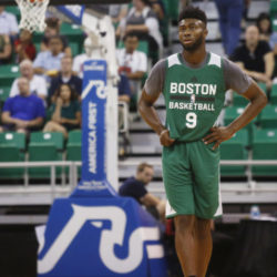 Boston Celtics' Jaylen Brown stands on the court in the second half of an NBA Summer League basketball game against the Philadelphia 76ers on Monday, July 4, 2016, in Salt Lake City. (AP Photo/Kim Raff)